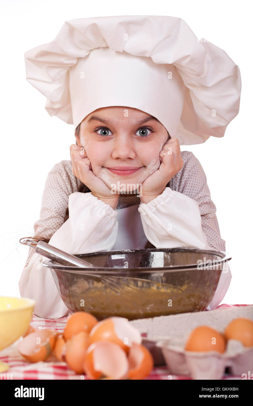 White apron girl - Little Girl In A White Apron Breaks Near The Plate With Eggs Isolated On White Background