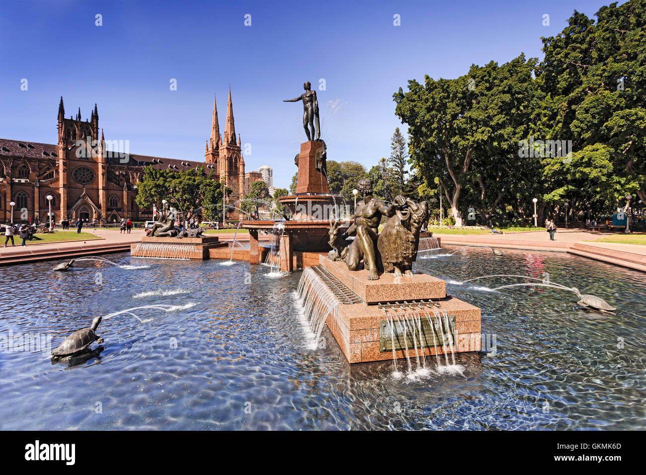 Water fountains hyde park - Bright Sunny Day In Sydney S Hyde Park Fresh Water Fountain Pool Surrounded By Tall Green Trees And St Mary S Cathedral