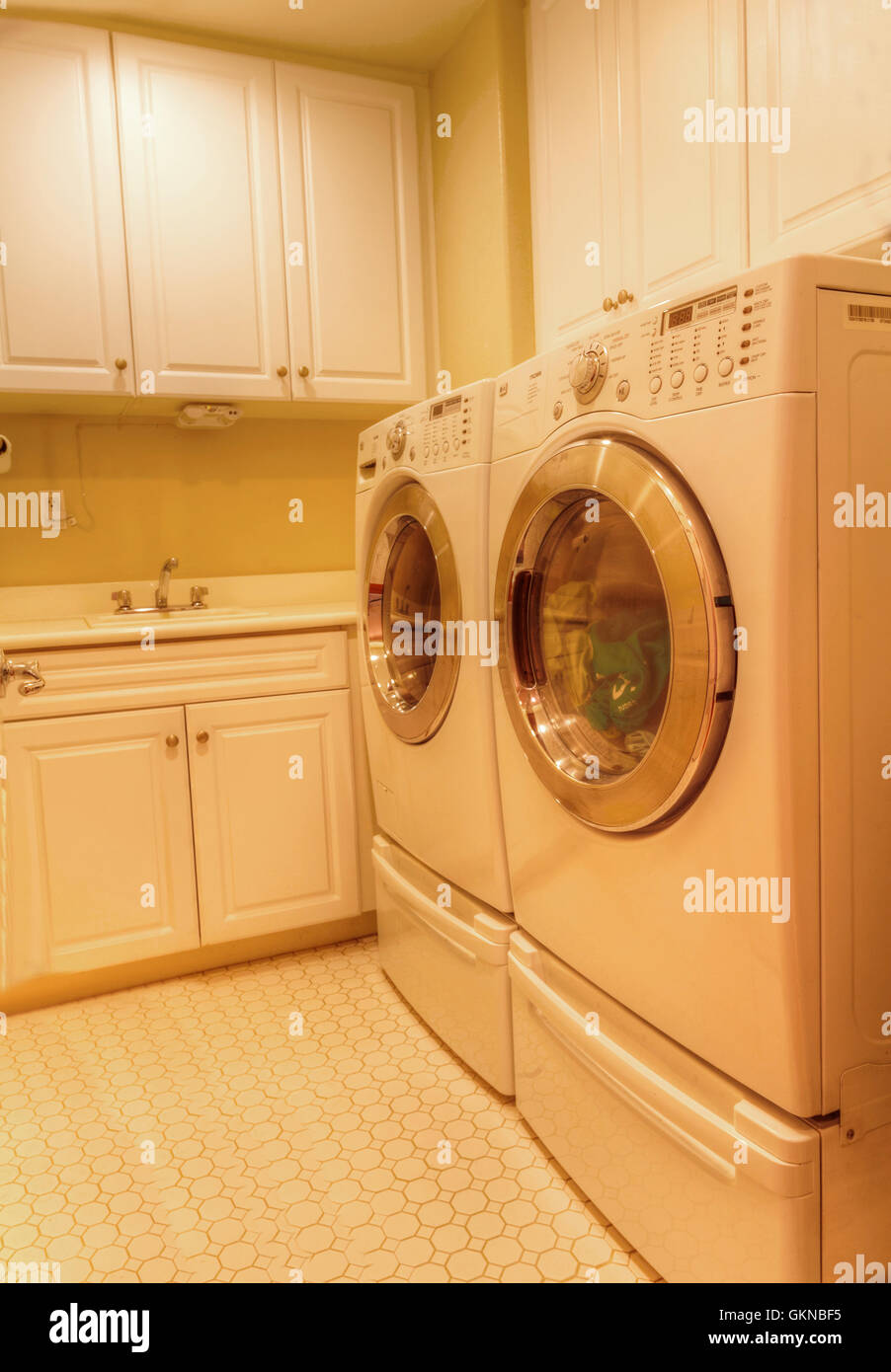 Laundry room cabinets irvine ca - Irvine Ca Usa August 19 2016 Small Laundry Room With Washer Dryer Recessed Lighting Tile Floors And Feng Shui Decor And