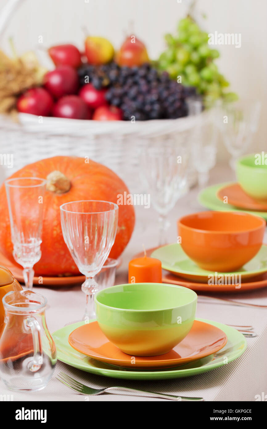 Thanksgiving Day. Festive Lunch With Traditional Table Decoration    Pumpkins, Fruits And Vegetables. Table Setting In Orange And