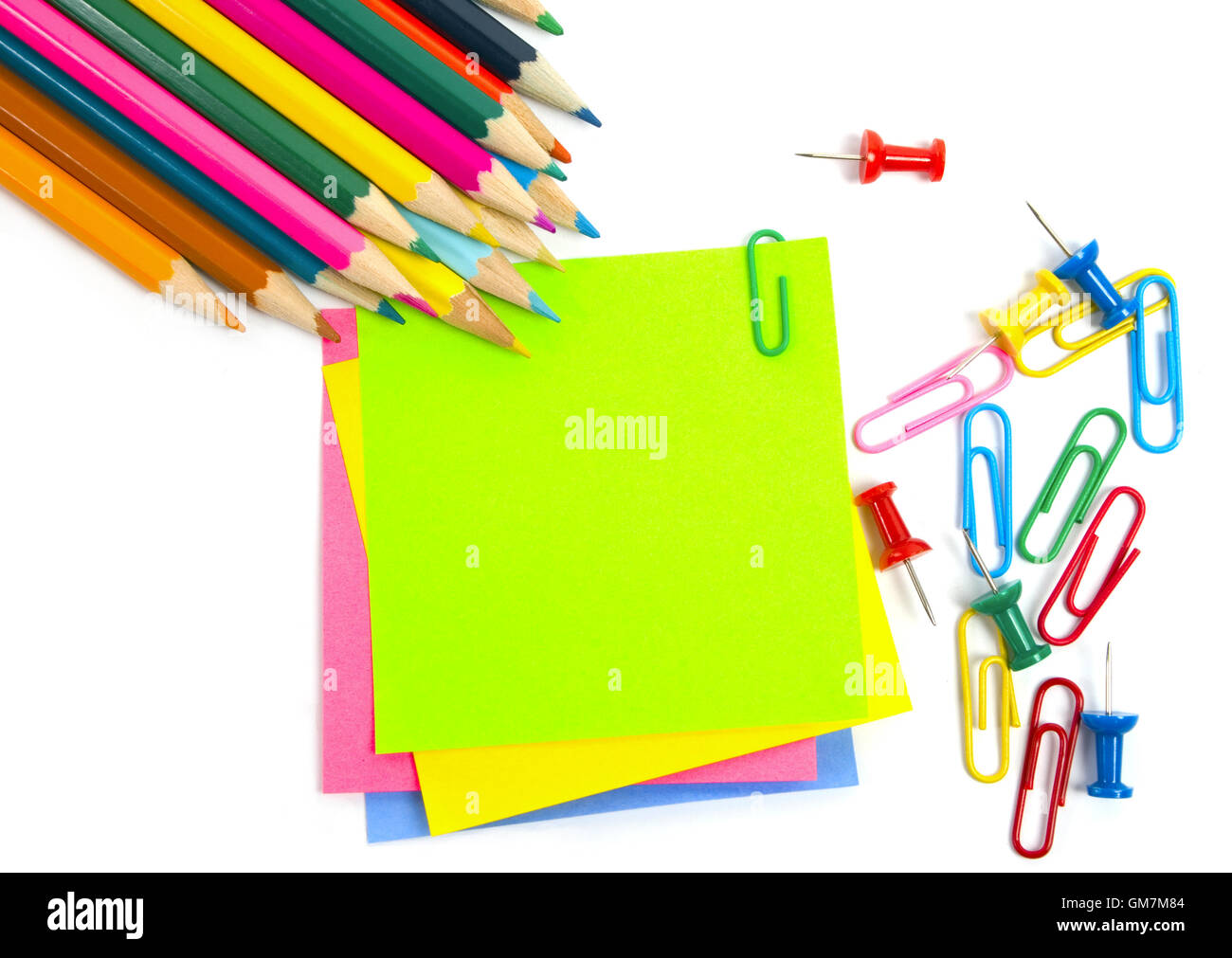 Colored Pencil, Clips And Note Paper On White  Colored Writing Paper