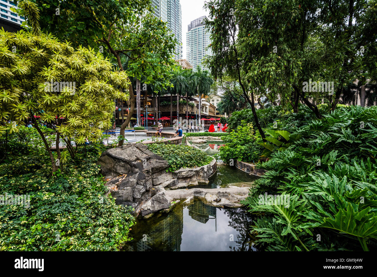 Garden And Skyscrapers At Greenbelt Park In Ayala Makati Metro Stock Photo Royalty Free