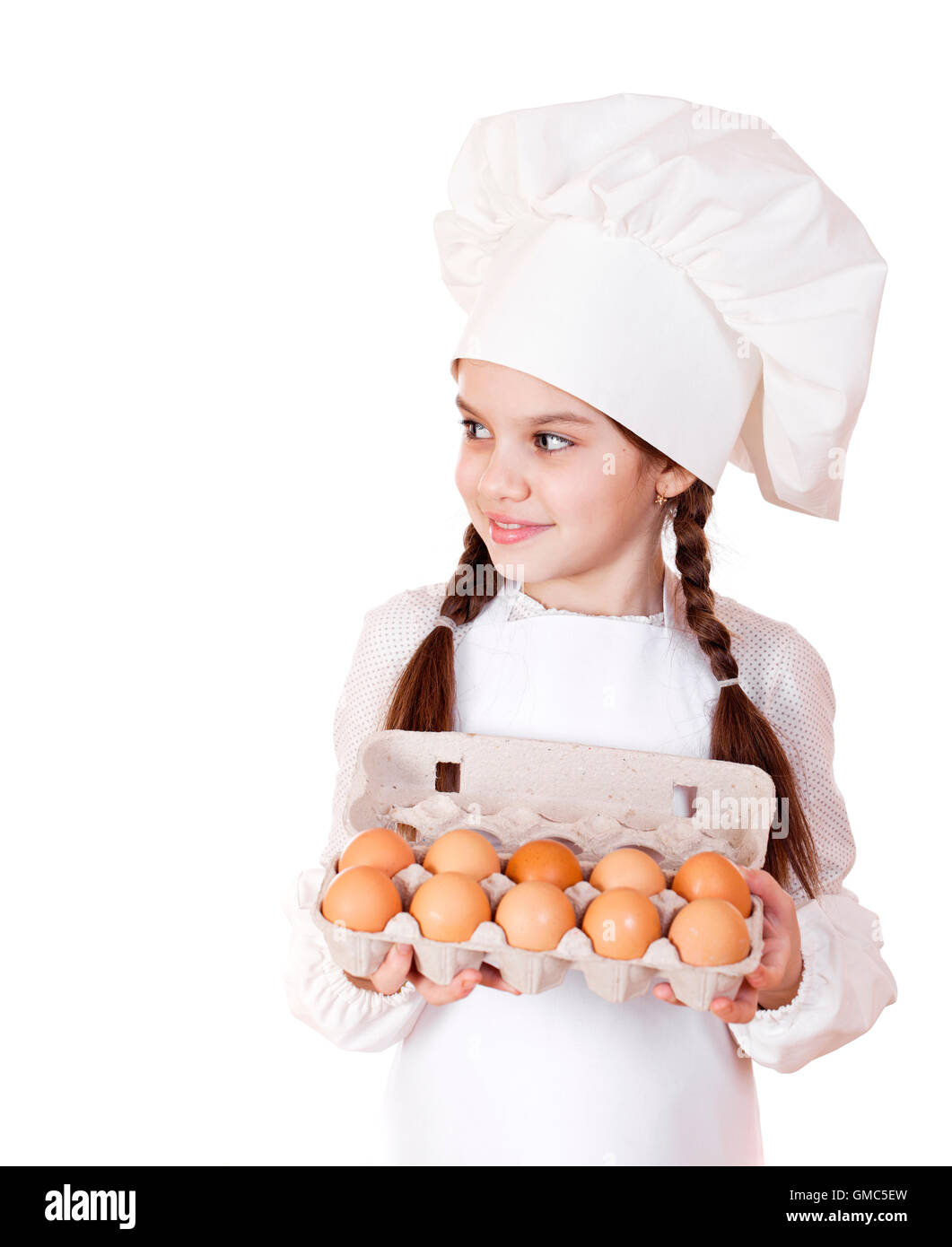 White apron girl - Portrait Of A Little Girl In A White Apron Holding Box Of Raw Eggs Isolated On White Background