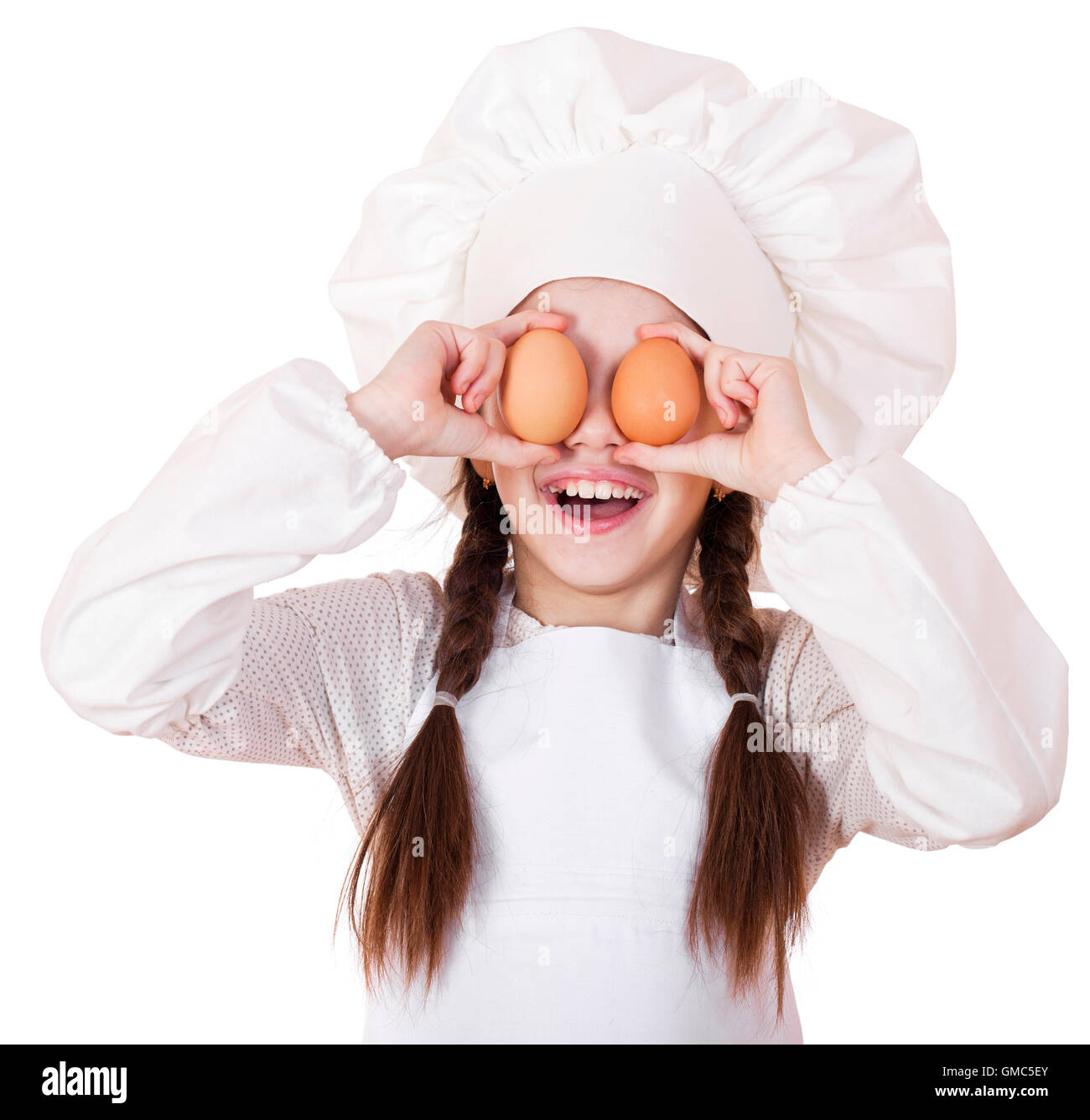 White apron girl - Portrait Of A Little Girl In A White Apron Holding Two Chicken Eggs Isolated On White Background