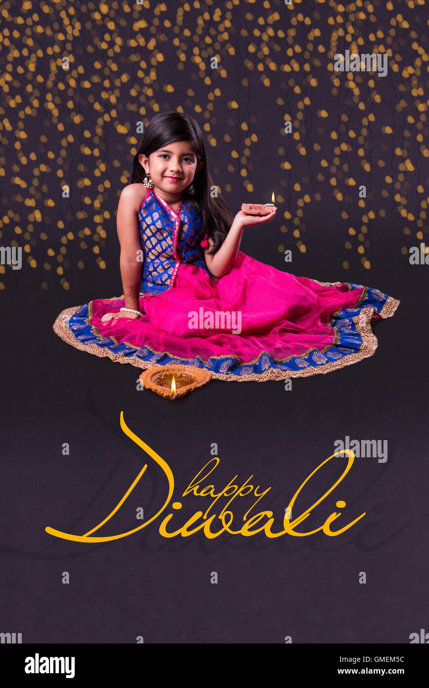 Ihappy diwali greeting card ndian girl holding diya on diwali or ihappy diwali greeting card ndian girl holding diya on diwali or posing in traditional wear kristyandbryce Image collections