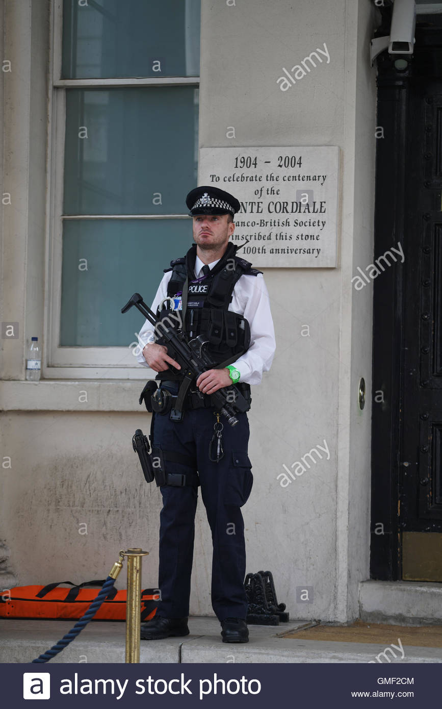 london uk th aug a police officer stands nearby the a police officer stands nearby the wear what you want beach party outside of the french embassy which was staged to show opposition to s burkini ban