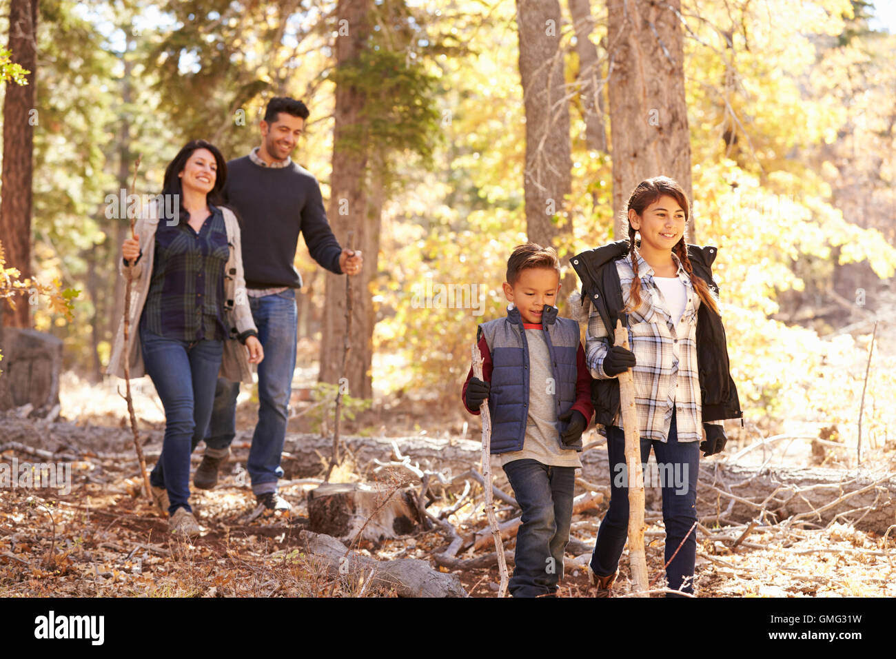 Close Up Of Happy Hispanic Family Hiking In Forest