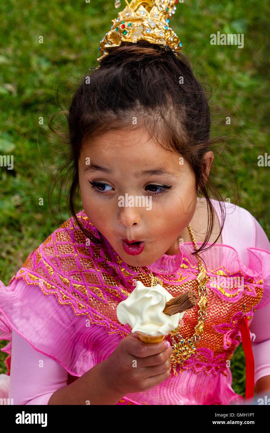 thai child An Anglo Thai Child Eating An Ice Cream At The Brighton Thai Festival,  Preston Park, Brighton, Sussex, UK