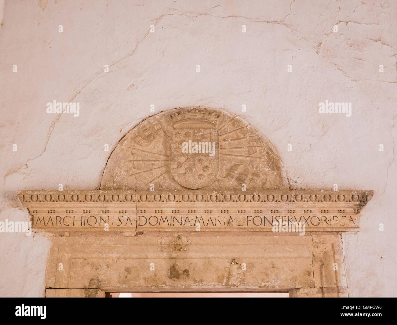 an italian renaissance decoration above a lintel with latin stock