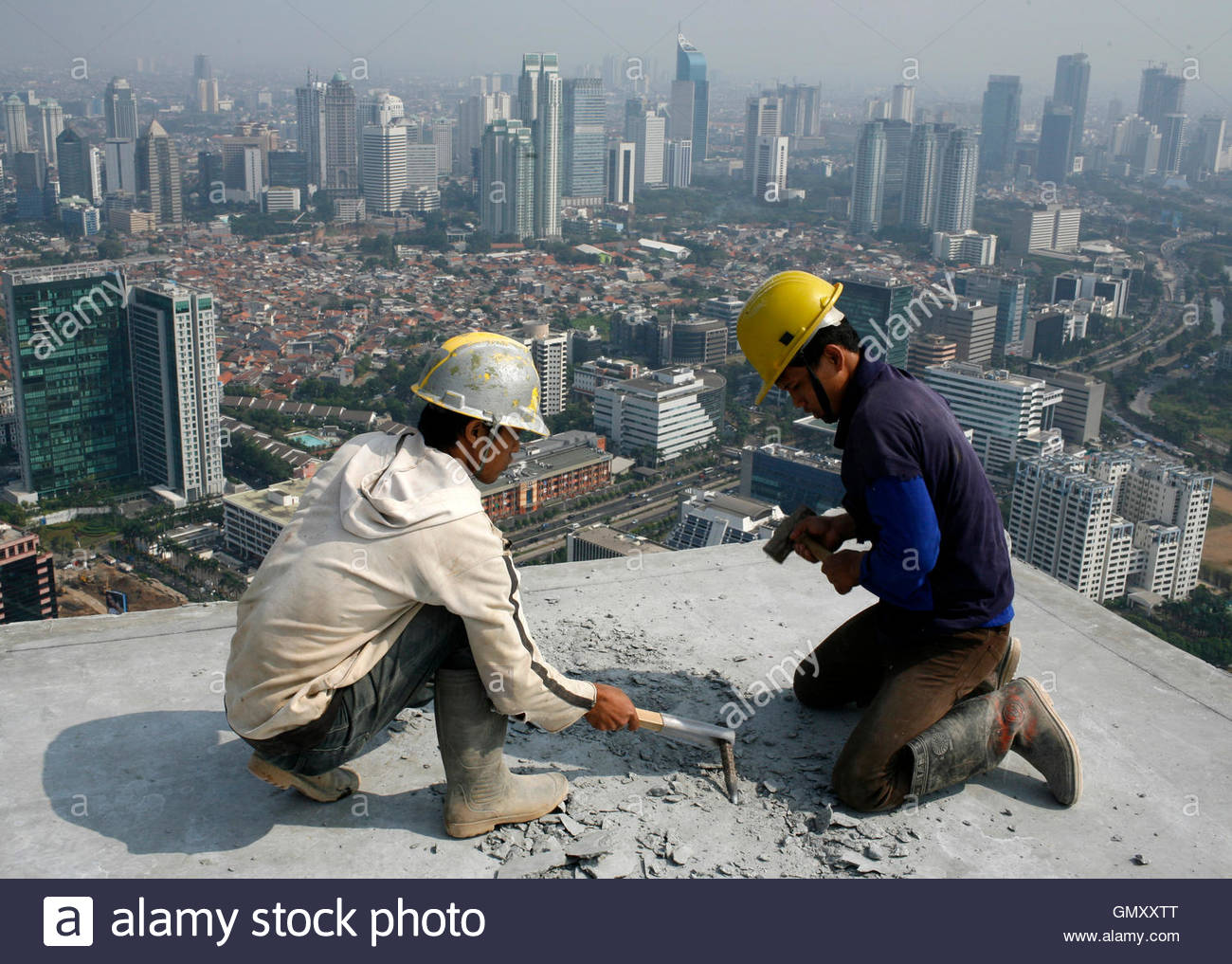 Stock Photo Workers Work At A Contruction Site To Build An Office Building And Shopping Mall