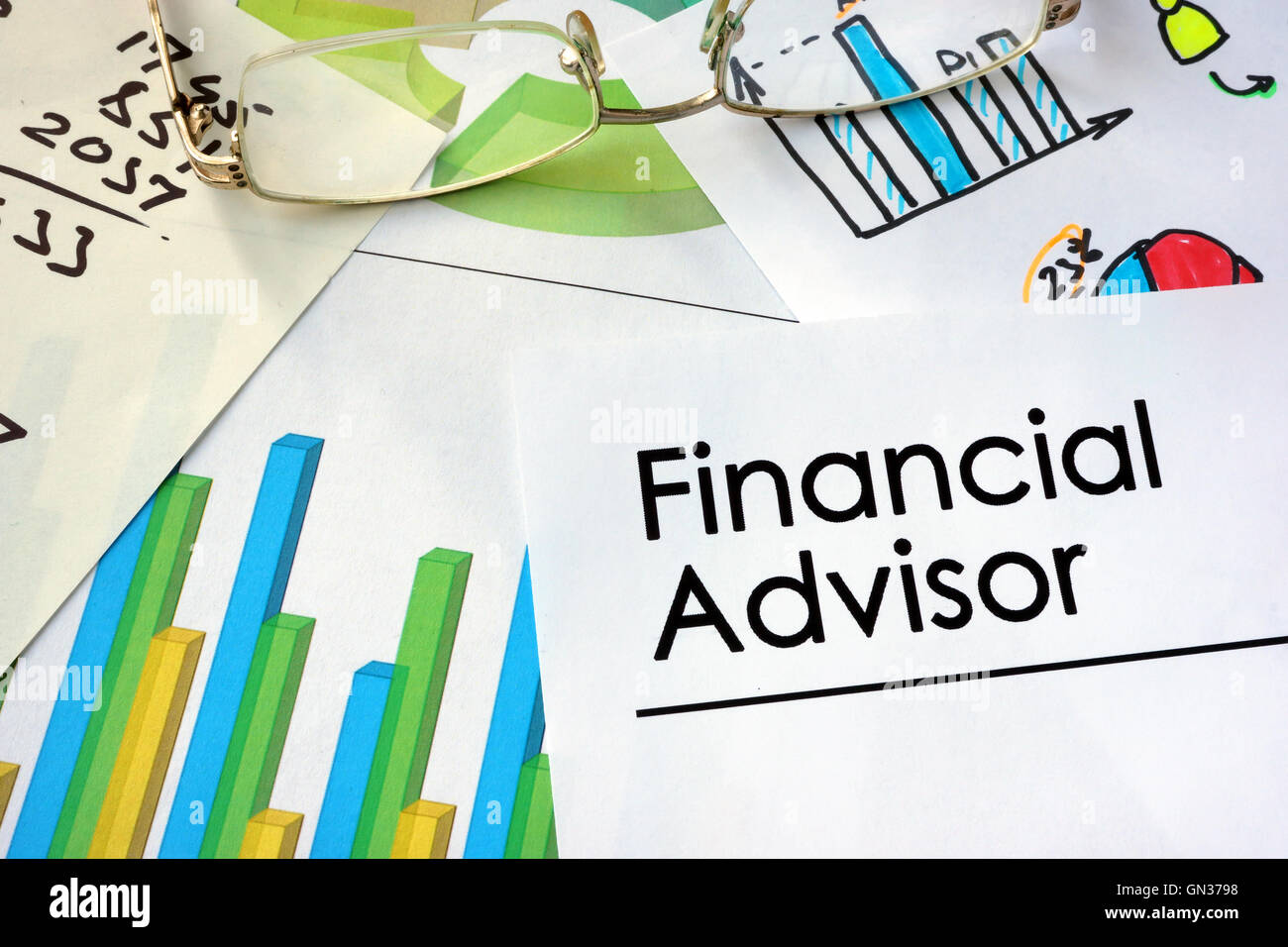 Paper with words Financial Advisor and charts Stock Photo, Royalty ...