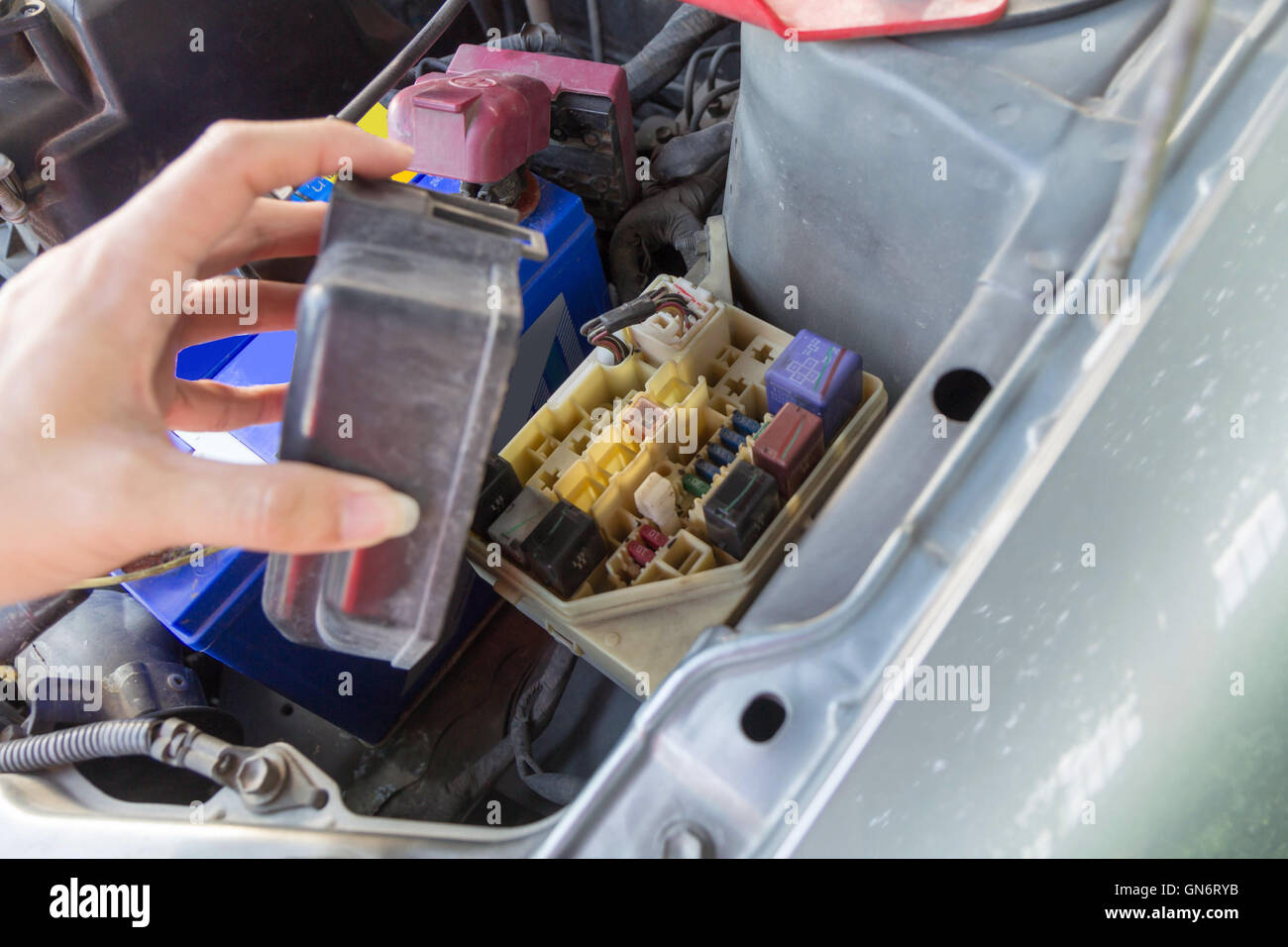 the man opening fuse box of old car GN6RYB the man opening fuse box of old car stock photo, royalty free how to open a fuse box on a 2017 ford f150 at crackthecode.co