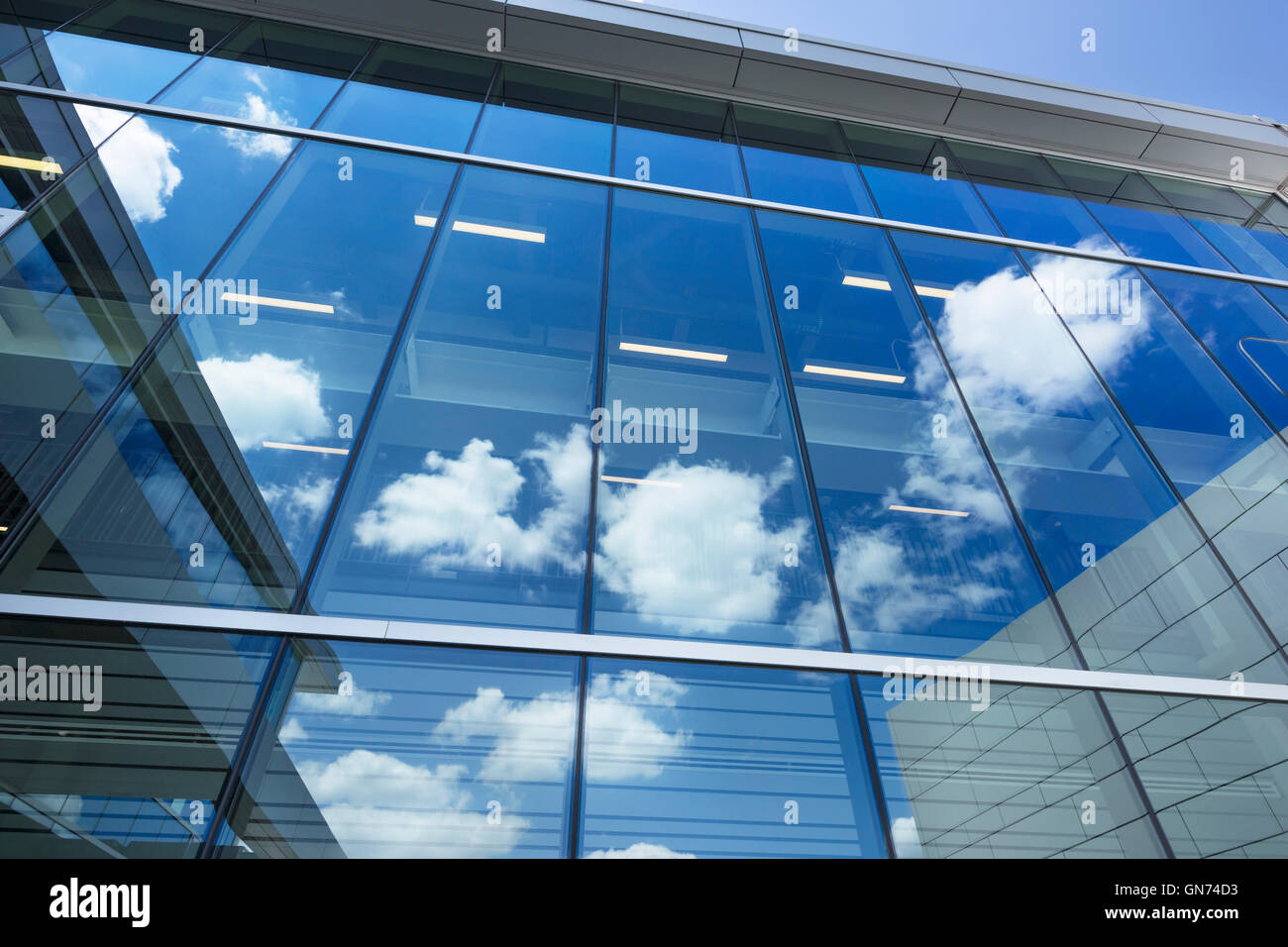 Glass office windows - Puffy White Clouds Blue Sky Reflected On Glass Office Building Windows