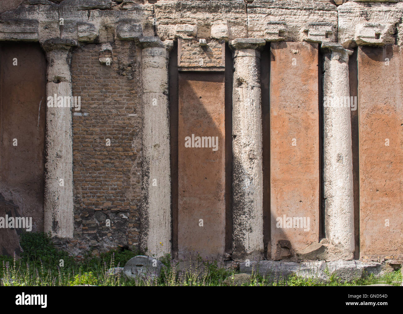Roman Architecture Columns typical orange color of the roman architecture, with four old
