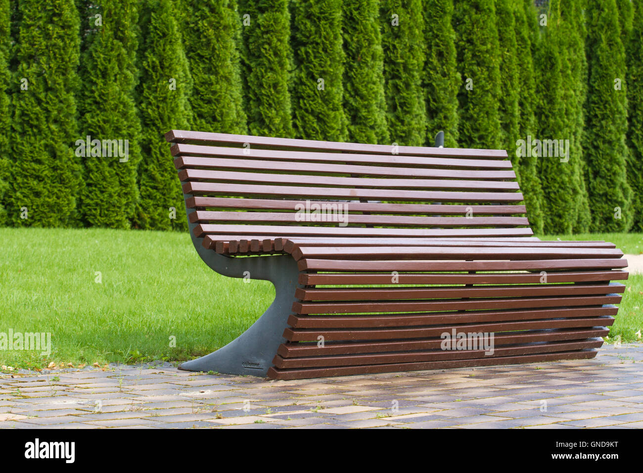 stylish curve shaped brown wooden bench outdoor furniture in the  - stock photo  stylish curve shaped brown wooden bench outdoor furniture inthe park as background image