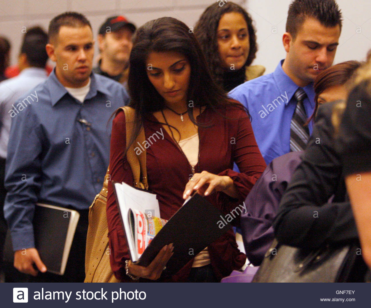 yamini patel nd l waits in line to talk to job recruiters stock photo yamini patel 2nd l 37 waits in line to talk to job recruiters at a career fair in los angeles 3 2009