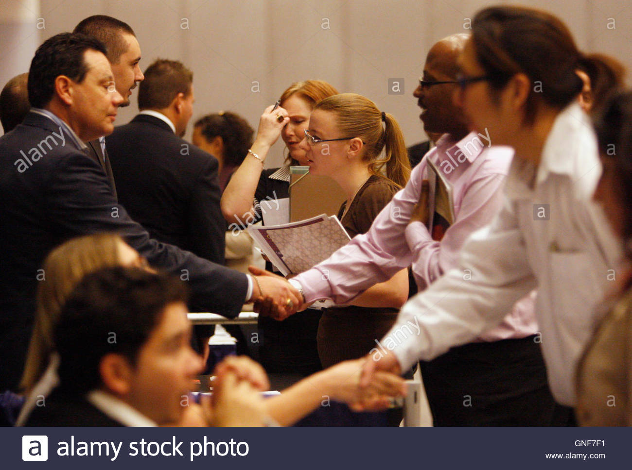 people talk to job recruiters at a career fair in los angeles people talk to job recruiters at a career fair in los angeles 3 2009 reuters lucy nicholson united states