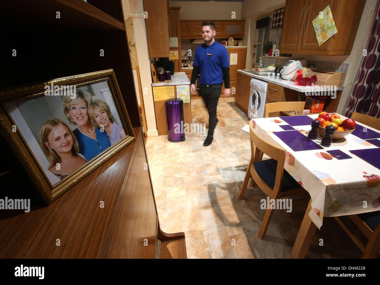 A Guide Sorts Cushions Inside The Set Of The Platts House At The