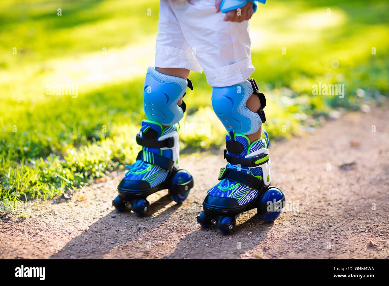 Roller skates winnipeg - Little Girl Learning To Roller Skate In Sunny Summer Park Child Wearing Protection Elbow And