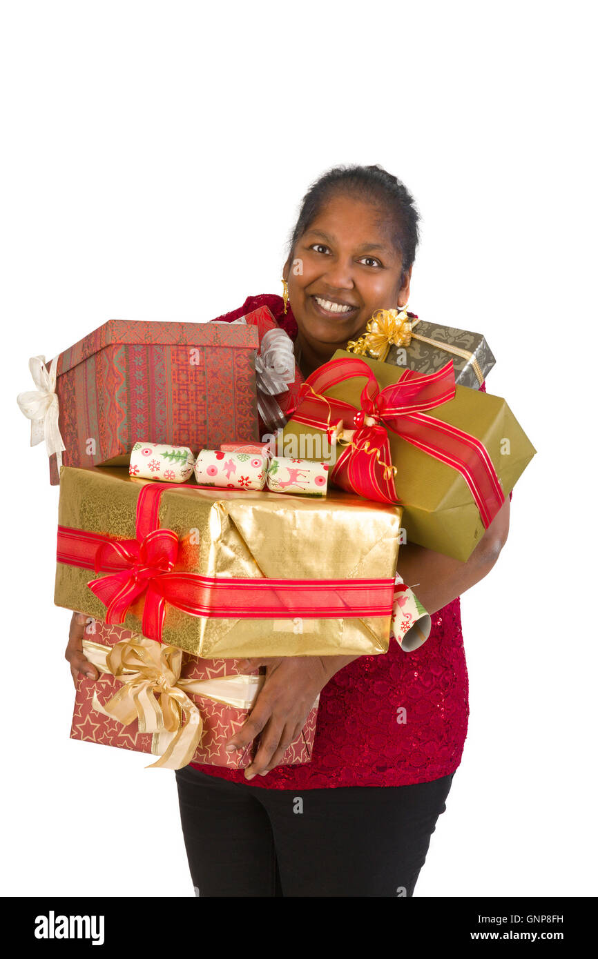 Smiling mature woman holding too many christmas presents Stock ...