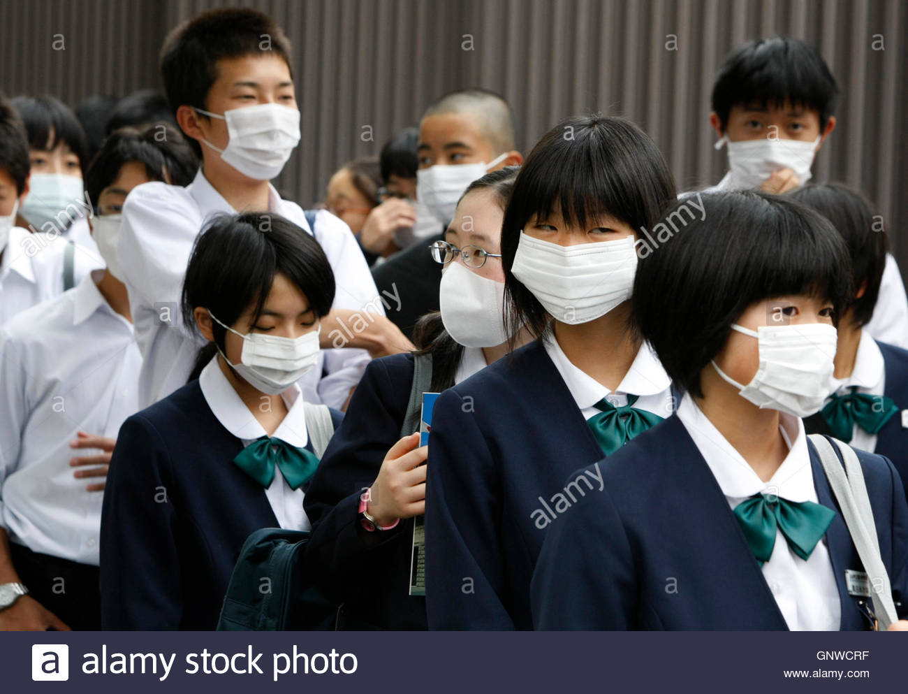 ese junior high school students wear face masks as they ese junior high school students wear face masks as they the parliament in tokyo