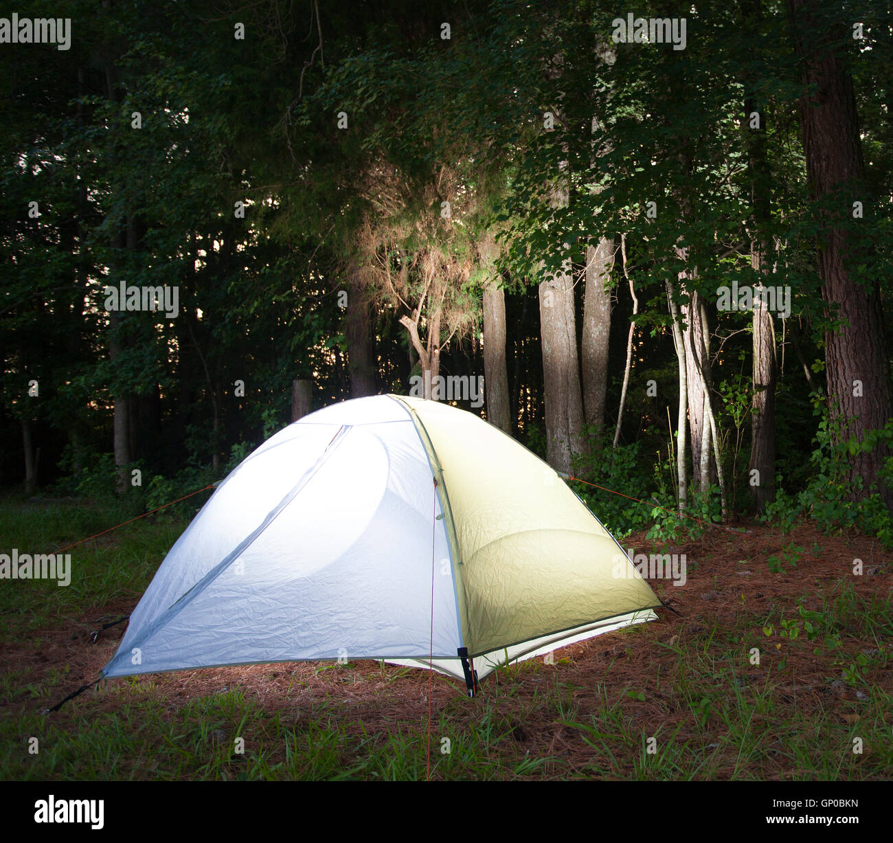 Backpacking tent with a light inside as evening falls on c& & Backpacking tent with a light inside as evening falls on camp ...