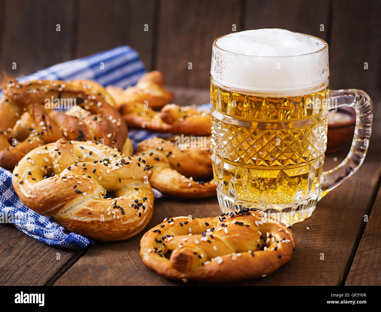Oktoberfest salted soft pretzels in a bowl and beer from ...