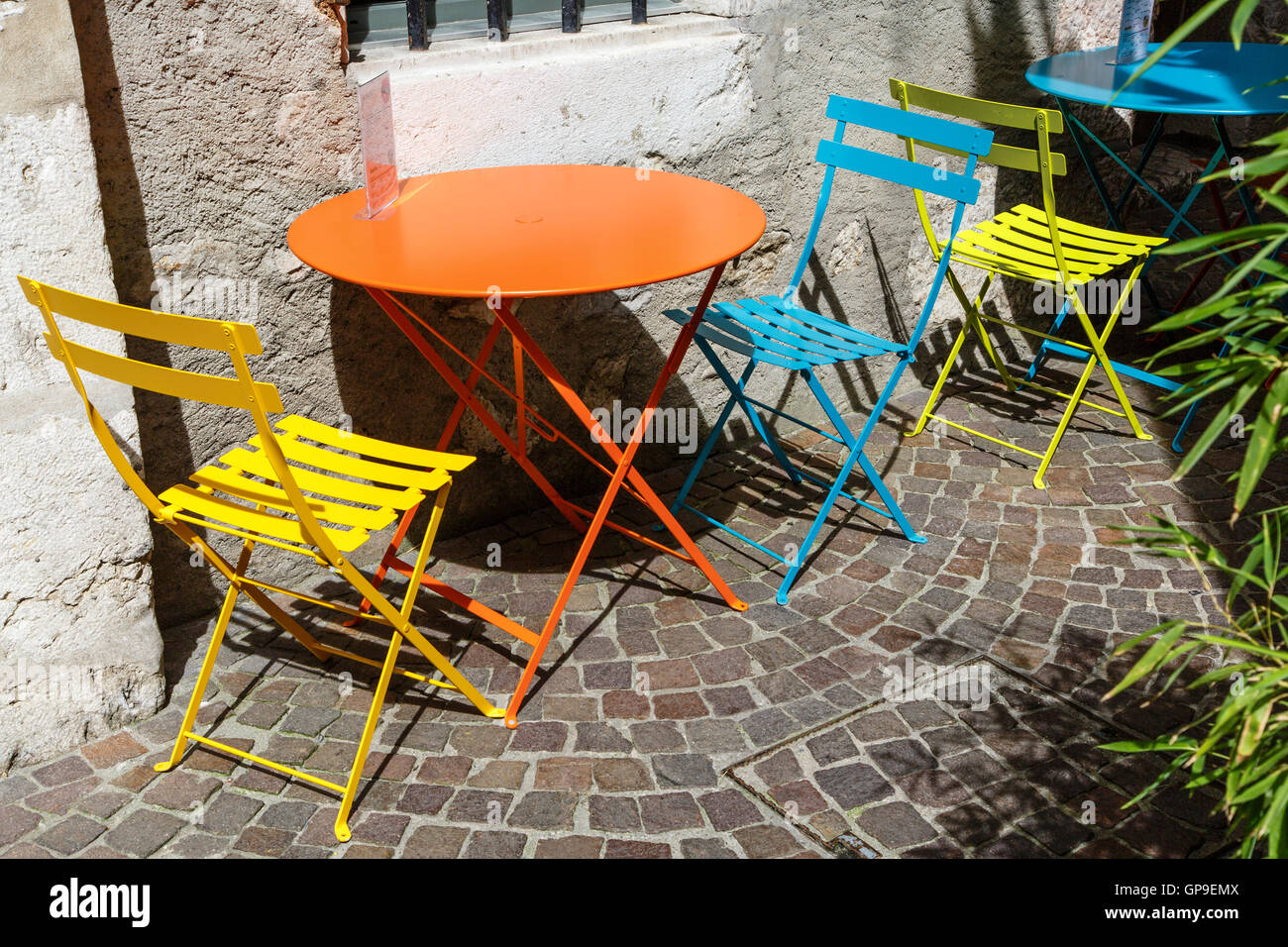 Colourful Table And Chairs In A French Pavement Café