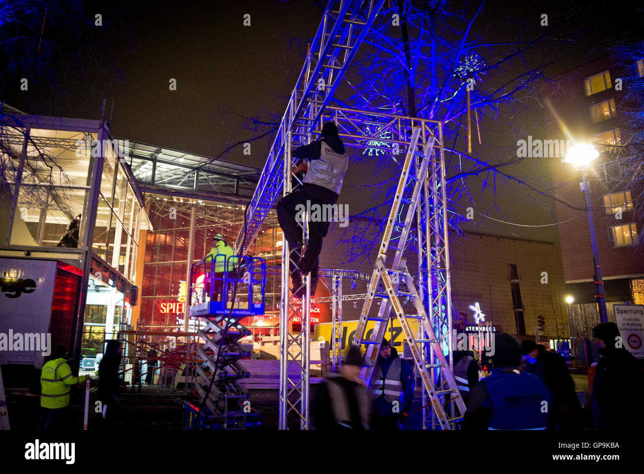 A man climbing lighting rigging on a pre-Berlinale construction site outside the Potsdamer Platz Theatre in Berlin Germany & A man climbing lighting rigging on a pre-Berlinale construction ... azcodes.com