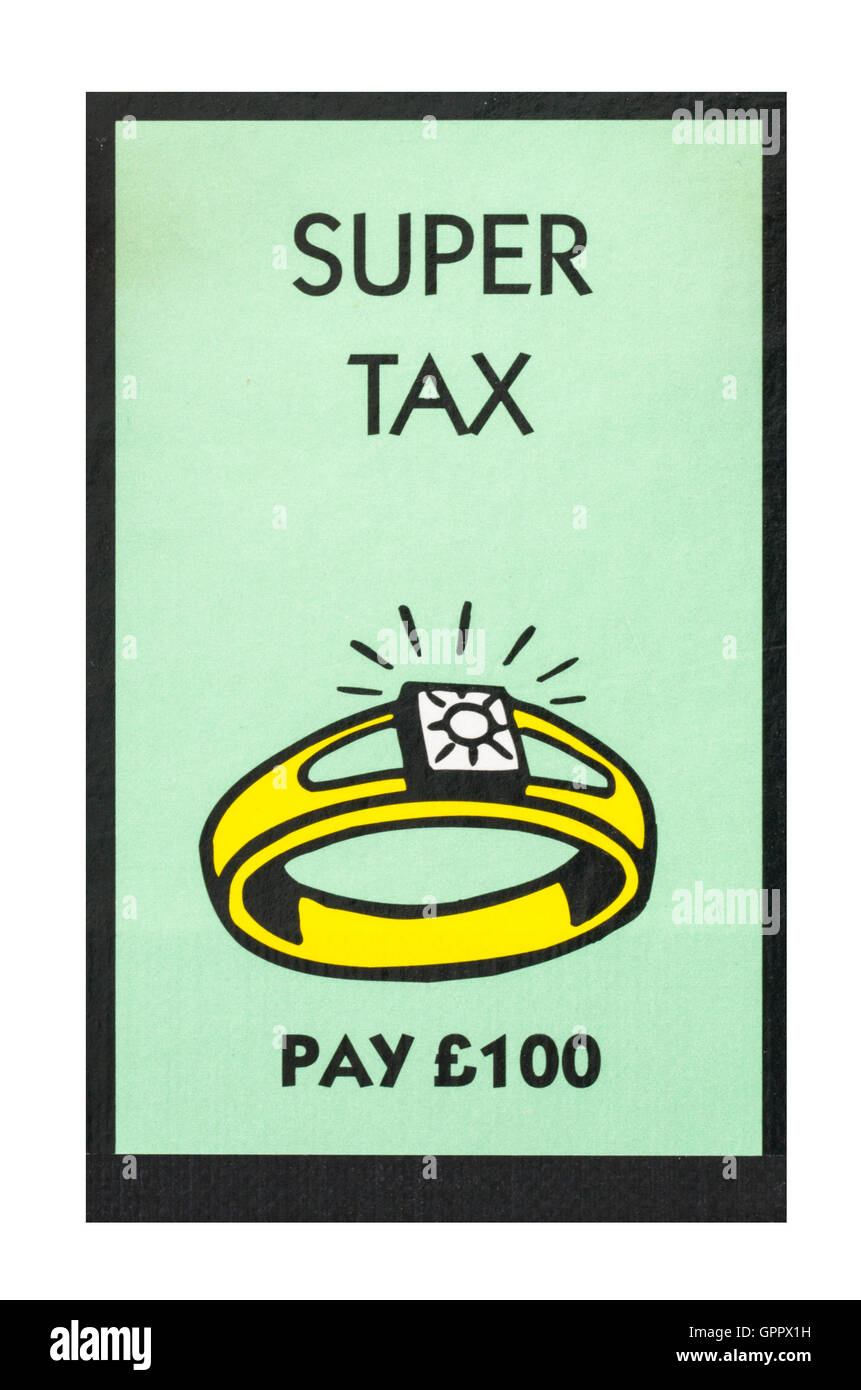 Monopoly board game showing super tax pay 100 the classic trading game from parker brothers