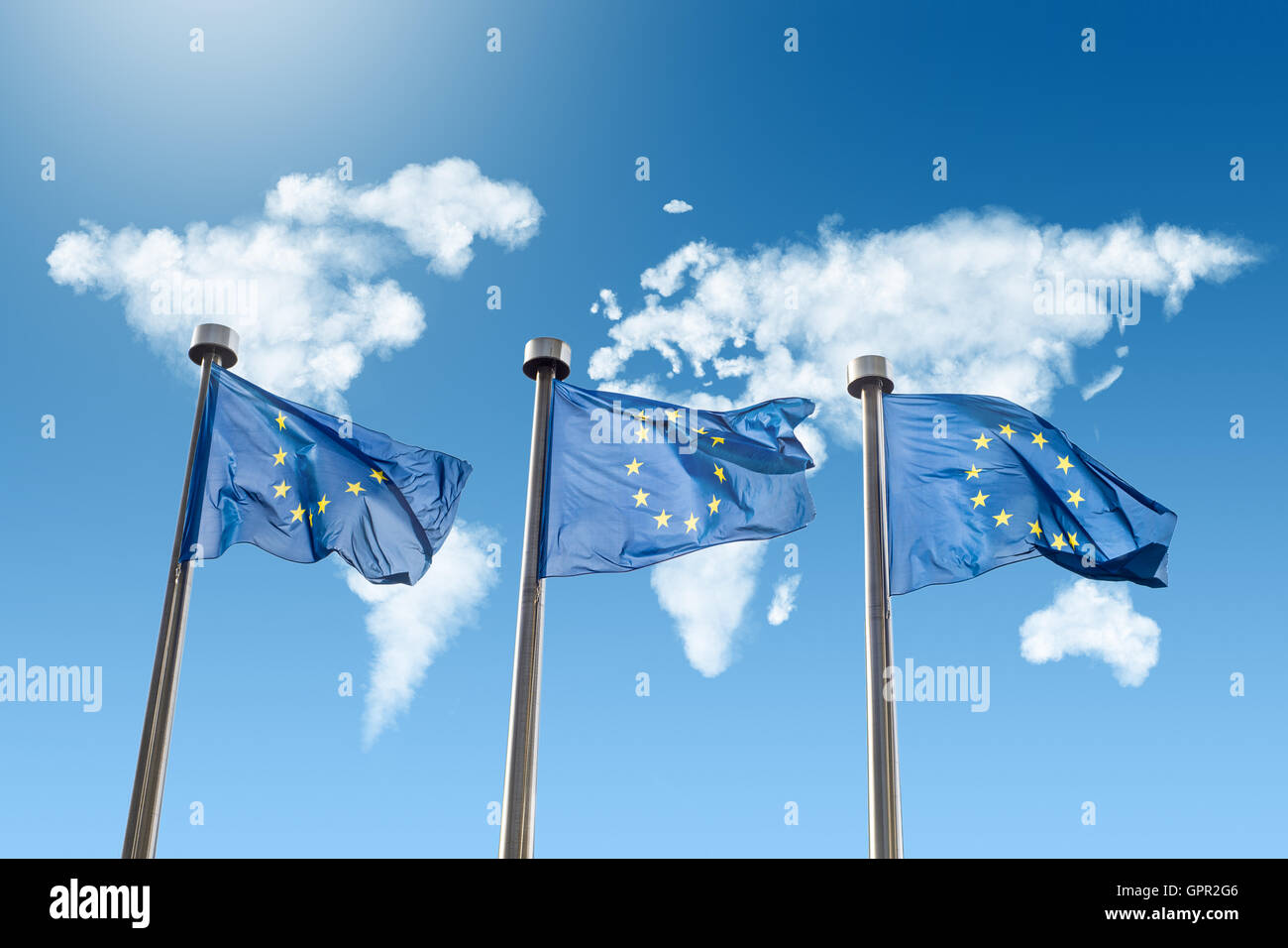 Eu flags against world map made of clouds stock photo royalty free eu flags against world map made of clouds gumiabroncs Gallery