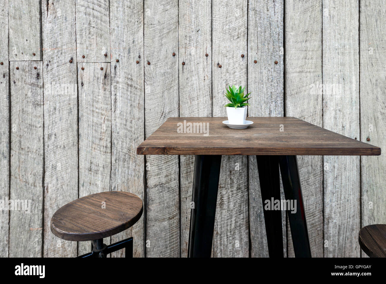 Vintage cafe table and chairs - Stock Photo Vintage Wooden Cafe Table With A Green Flower On Top In The Pot And Barn Wood On The Background