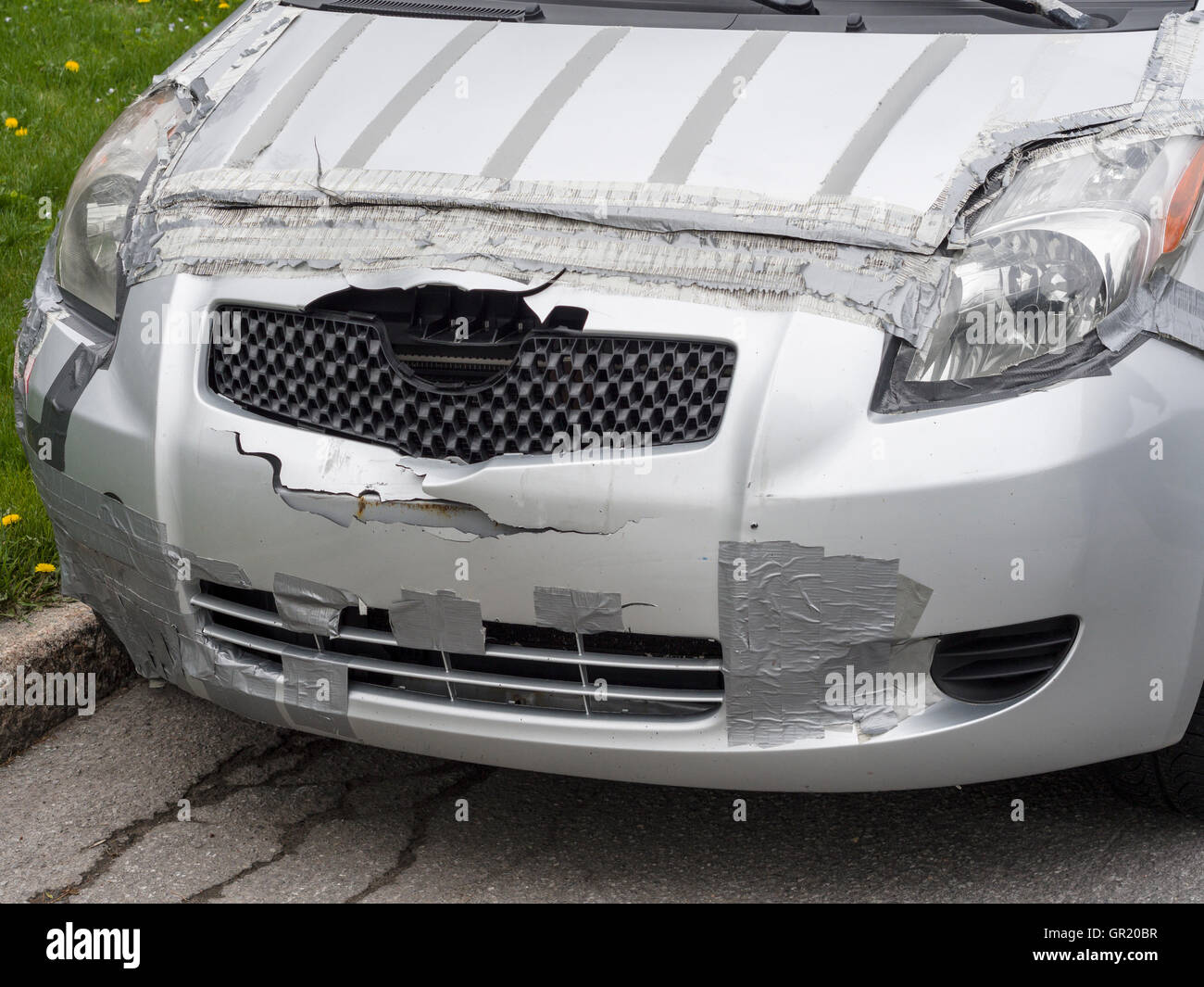 Tape Based Auto Repair A Silver Car Is Patched With Grey Duct After
