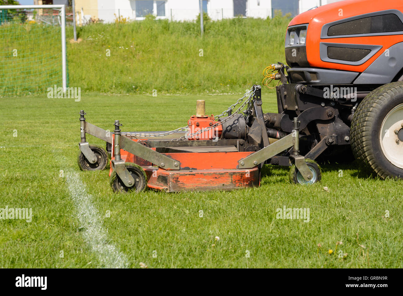 Rasenpflege  Rasenpflege - Sports Facility Is Mowed Lawn Tractor - Lawn Stock ...