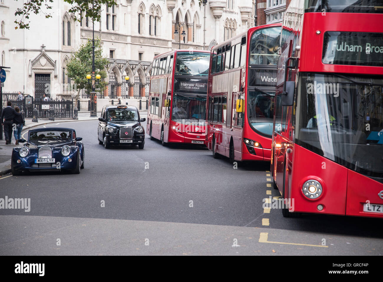 London Red Double Decker Buses Black Cab Taxis And Morgan Sports