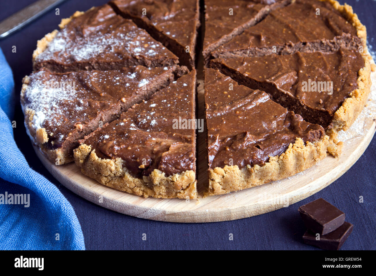 Homemade chocolate pie (cheesecake) with sugar powder close up ...