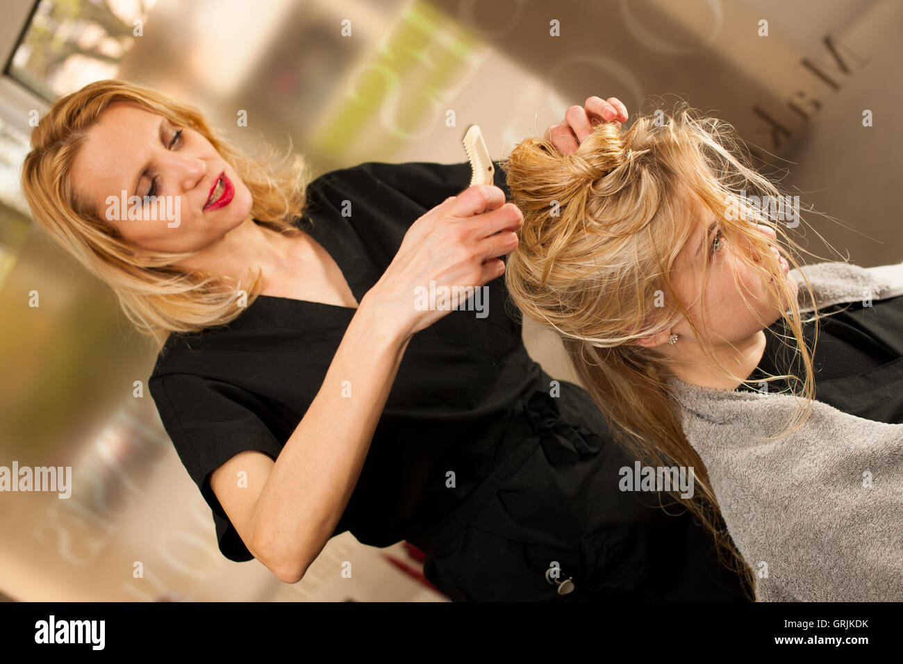 Professional hair stylist at work
