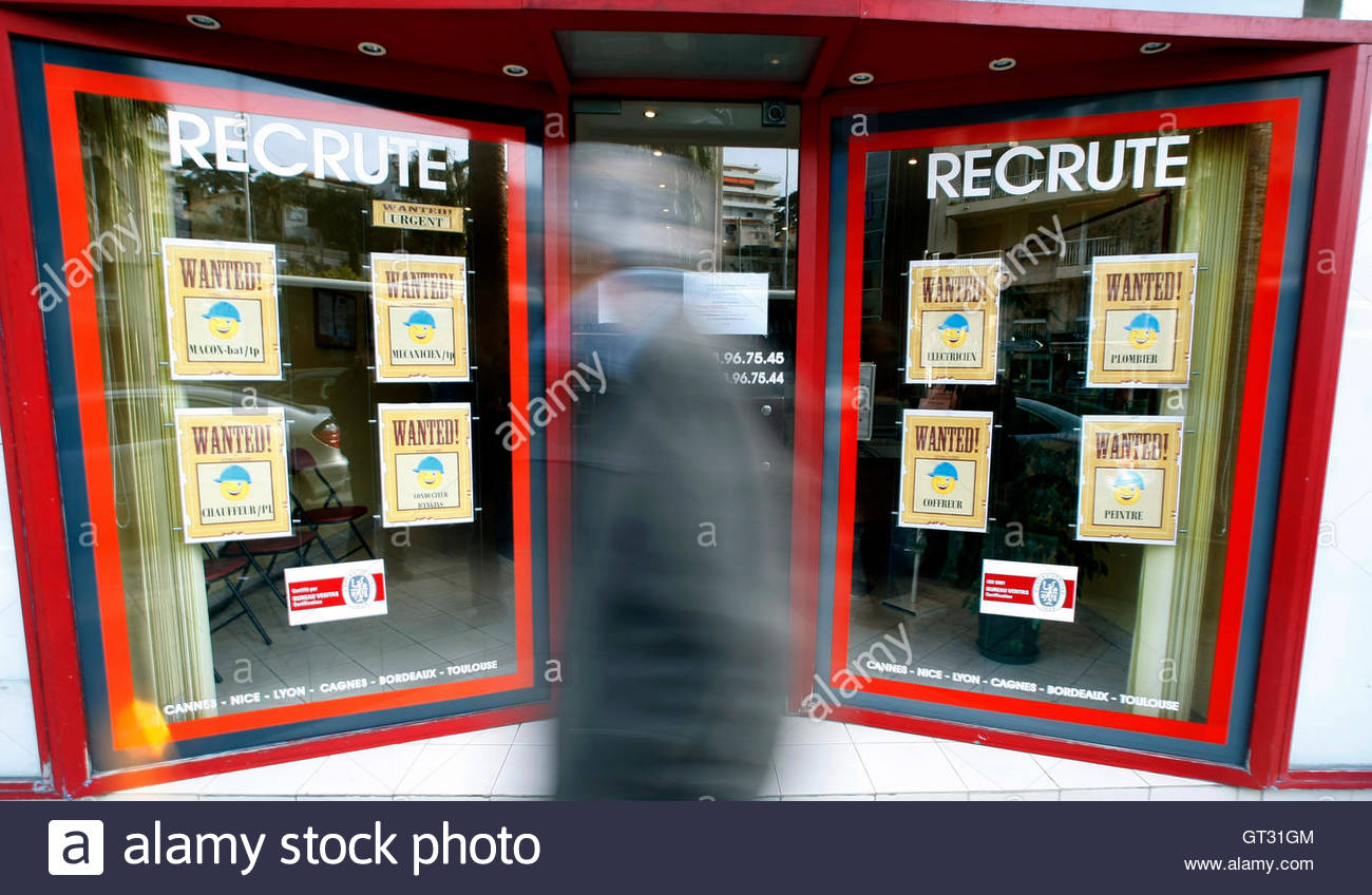 a man walks past a temping agency in nice  a man walks past a temping agency in nice 26 2009 french headline