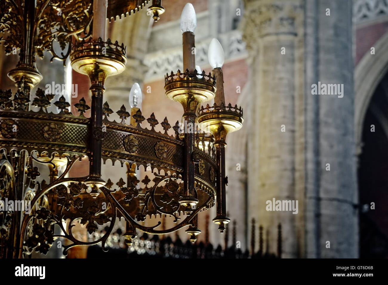 Decorated chandelier in st michiels church in ghent belgium on decorated chandelier in st michiels church in ghent belgium on july 19 2016 colored with sun beams from stained glass window arubaitofo Image collections
