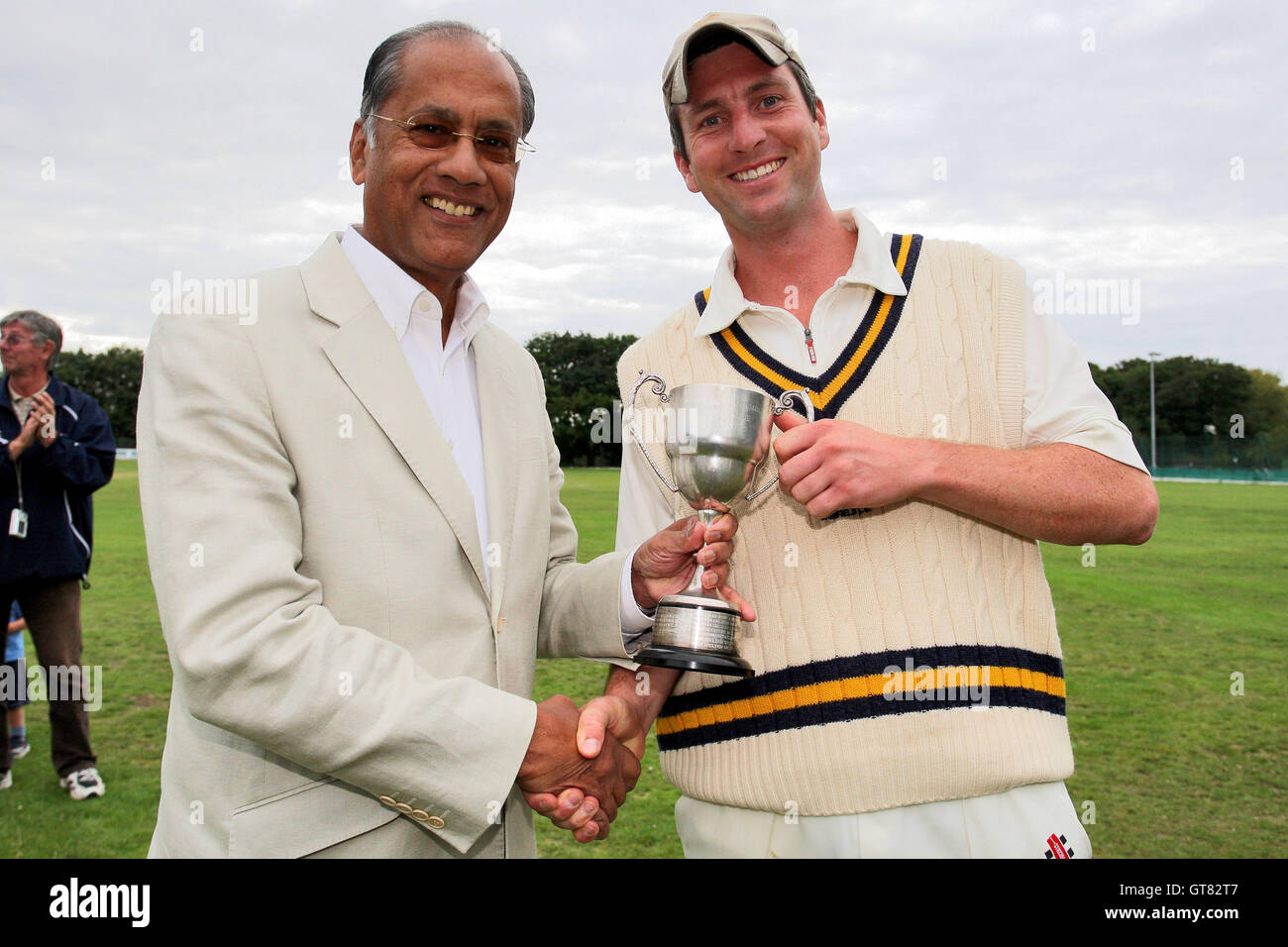 Dilip Jajodia of Dukes L presents the cup to Shenfield captain