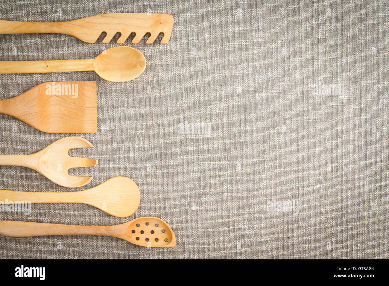 Kitchen Utensils Border Wooden Cooking Utensils For Food Preparation Arranged In A Curving