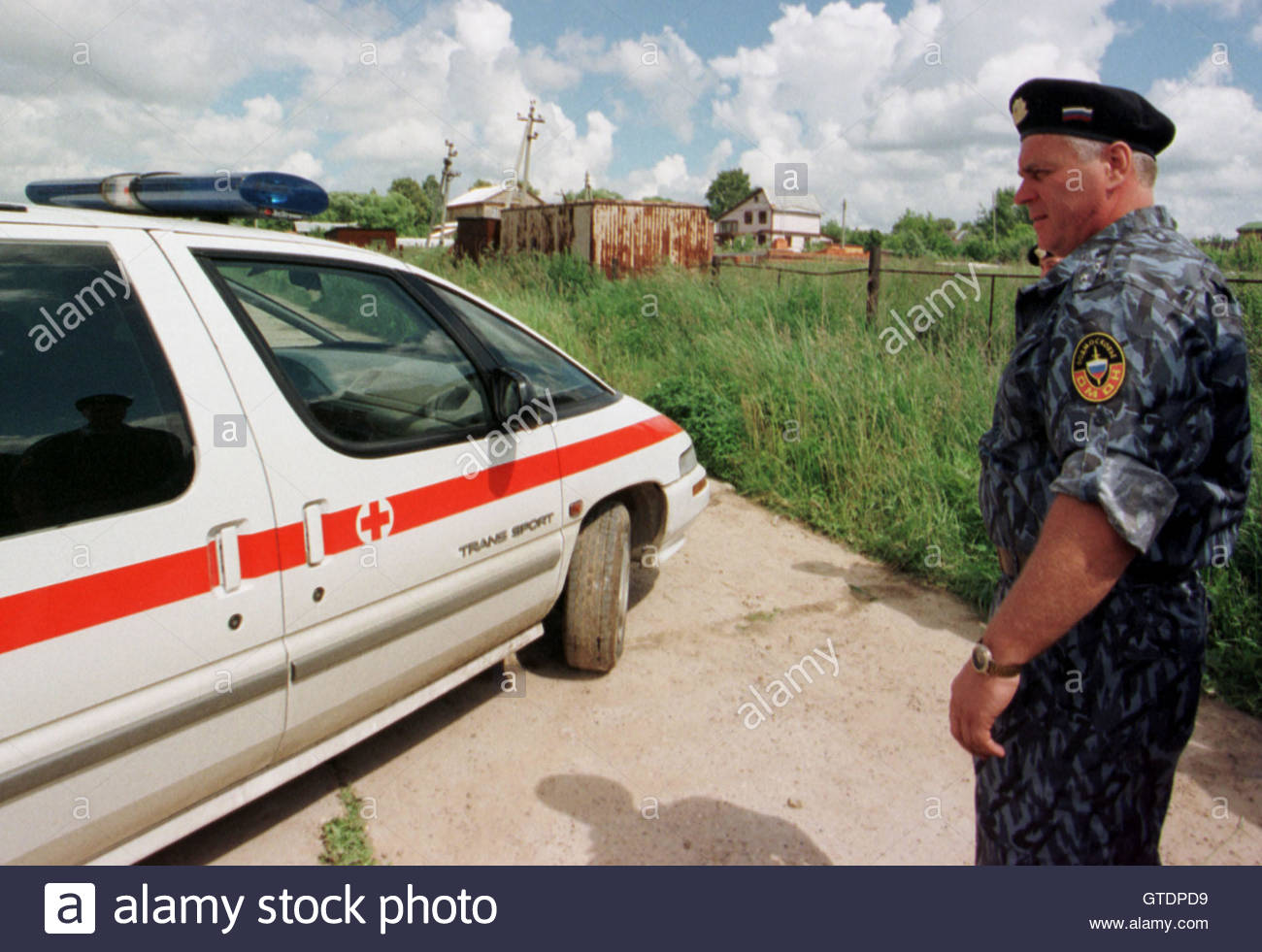 omon special police officer watches the ambulance carrying the omon special police officer watches the ambulance carrying the body of retired general lev rokhlin