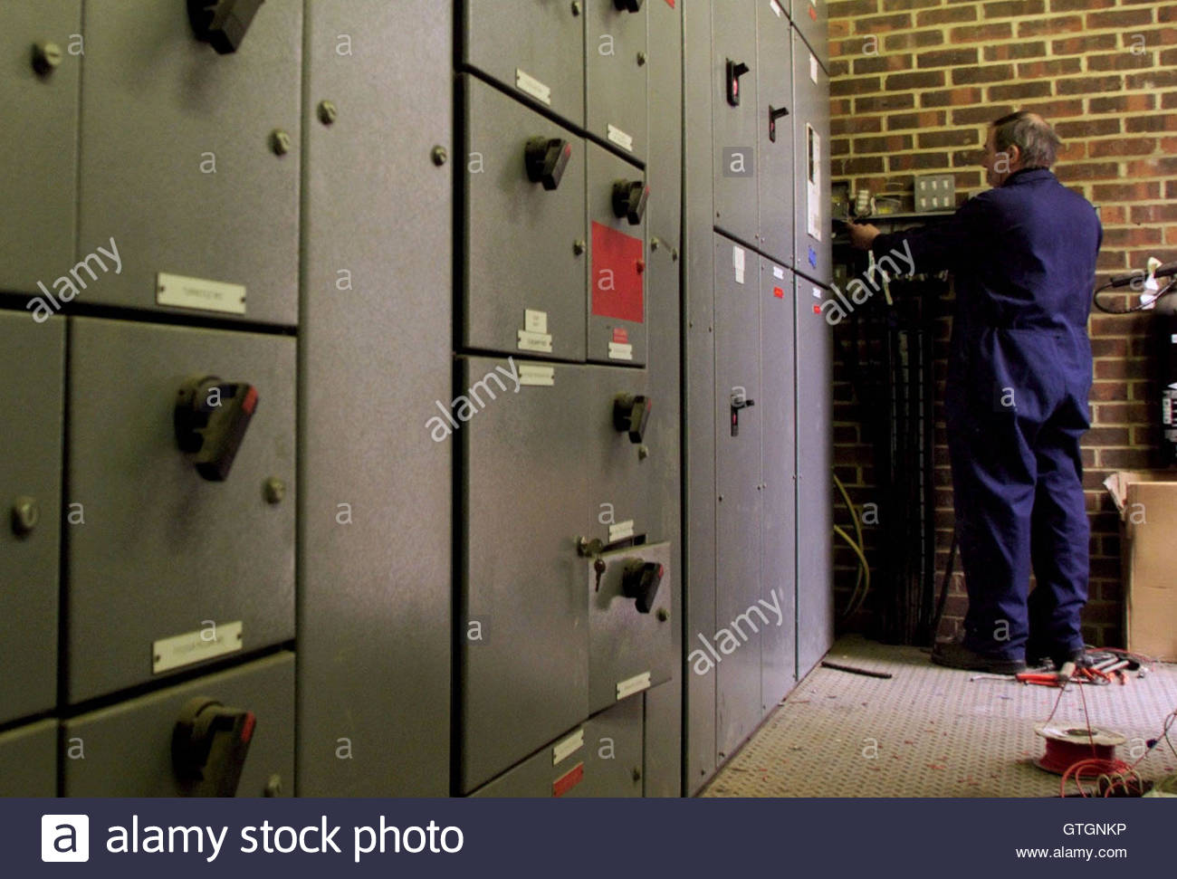 an electrician repairs the fuse box controlling the flood lights an electrician repairs the fuse box controlling the flood lights at charlton athletic football ground 12 charlton s floodlights were alledgedly