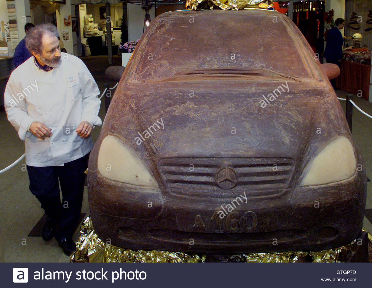 French confectioner Marc Debailleul examines a chocolate model of ...
