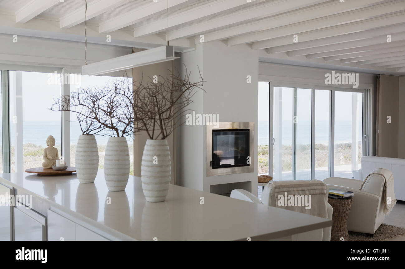Modern White Vases With Branches On Kitchen Island In Beach House