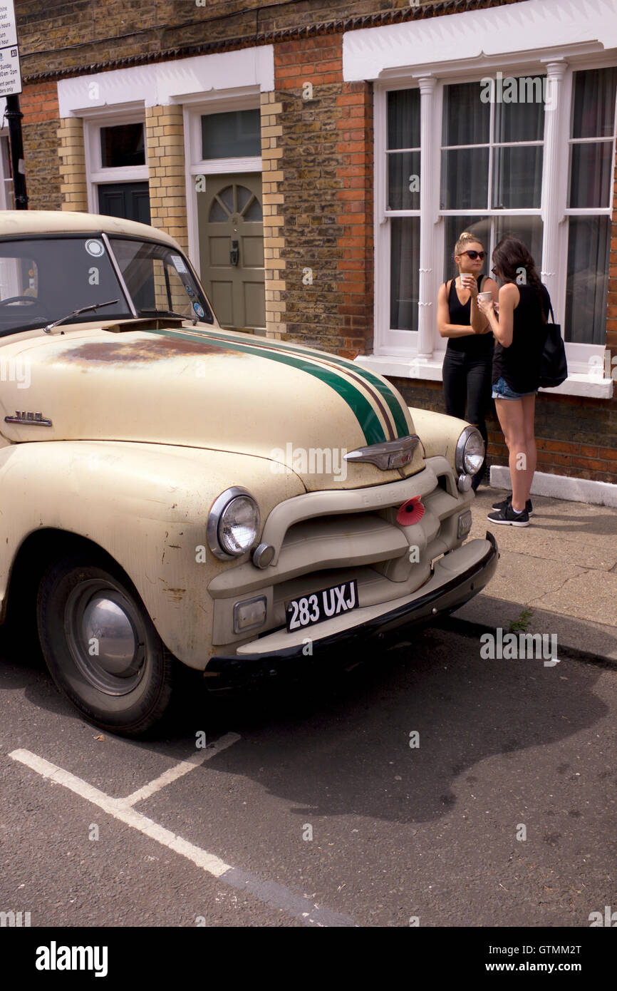 Old car and two friends, Columbia Road, Bethnal Green, London, UK ...