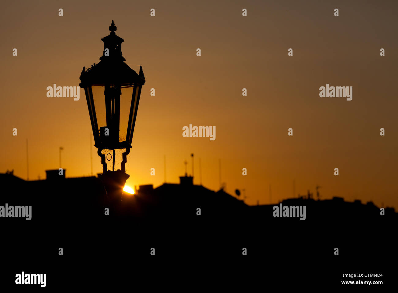 Ancient Lamp In Prague Against Sunrise