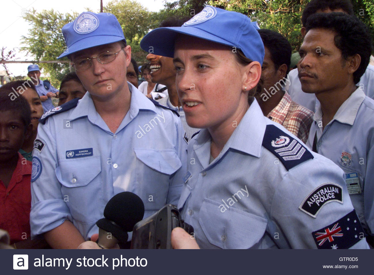 Australian Federal Police officers Kate Ferry (R) and Sandra Stock ...