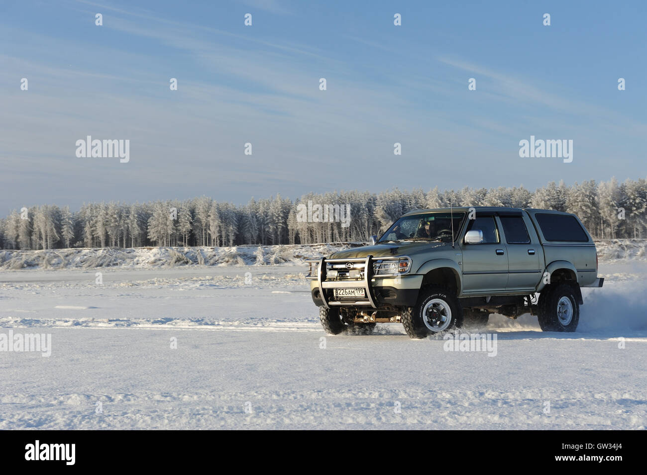 Great wall deer pickup driving on snowy river beach stock for Great wall motors stock