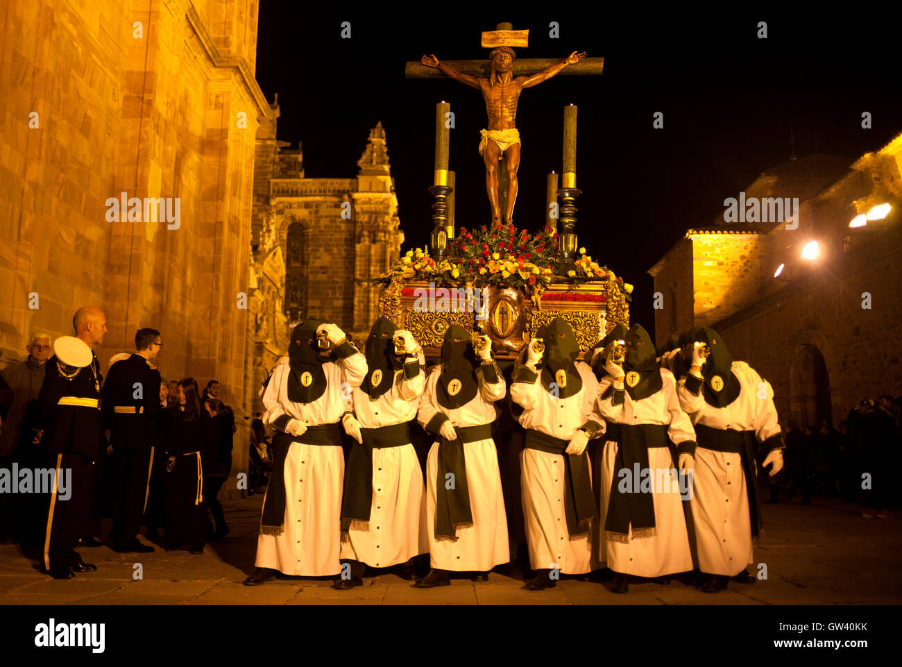 penitents carry an image of jesus christ crucified during an